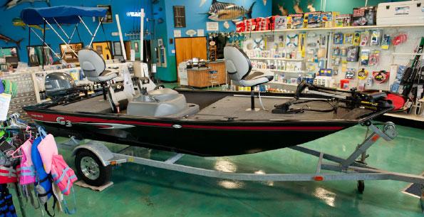 a g3 aluminum boat inside the dealership