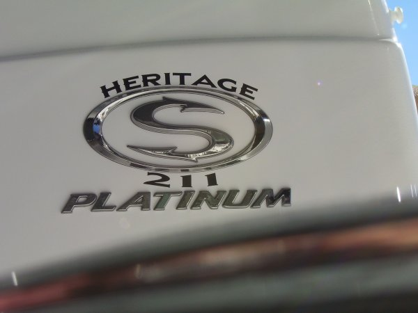 A 211 Heritage Platinum is a Power and could be classed as a Bay Boat, Center Console, Fish and Ski,  or, just an overall Great Boat!