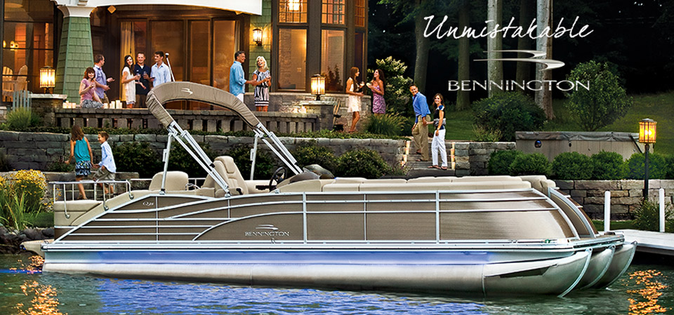bennington pontoon boat at the dock of a very nice house
